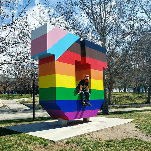 Mars sits in the Block U installation on the University of Utah campus. the U is wrapped in rainbow colors representing the LGBTQIA pride flag