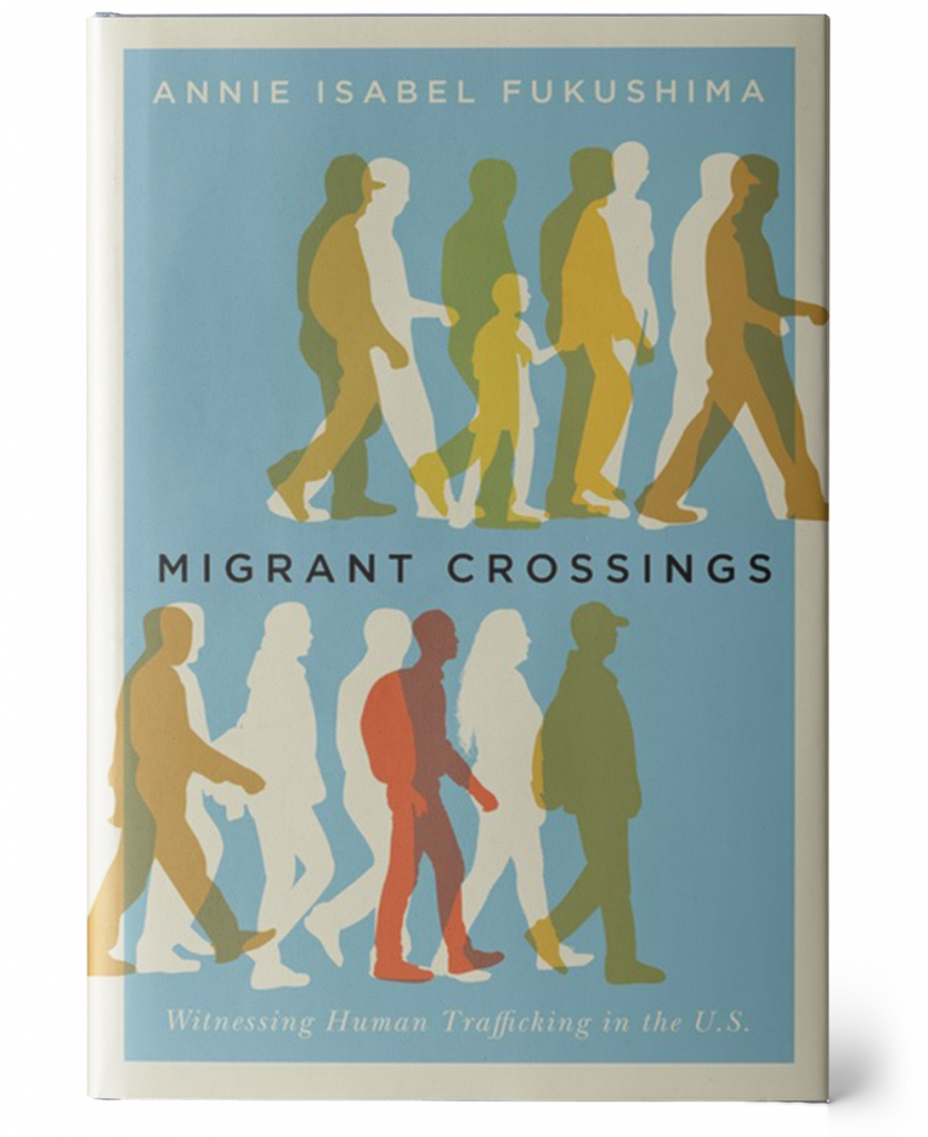 Attached is an image of a light blue book cover with a beige border. At the top of the cover reads the author's name in beige, 'Annie Isabel Fukushima'. Below the name are two rows of beige-colored silhouettes of people walking to the right. Superimposed on these silhouettes are translucent silhouettes in red, gold, and burnt orange also walking to the right. The main title of the book, 'Migrant Crossings', sits between the rows of people in a black. The beige subtitle, 'Witnessing Human Trafficking in the U.S.', is displayed at the bottom between the second row of people and the border.