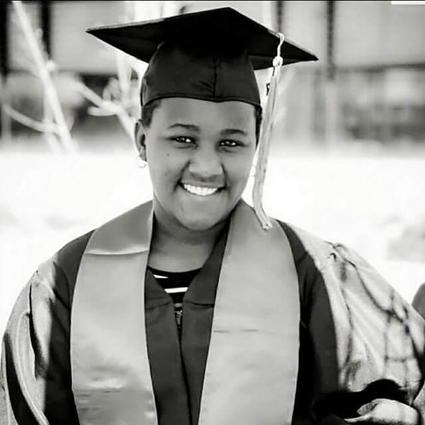 Naserian Montet smiling in her graduation regalia